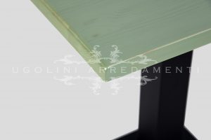 The matching table has a natural iron base and pine top